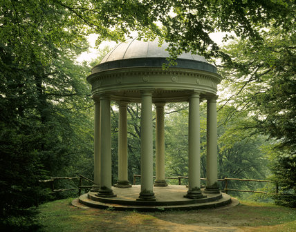 The Temple of Fame, a circular domed building amongst trees at Studley Royal