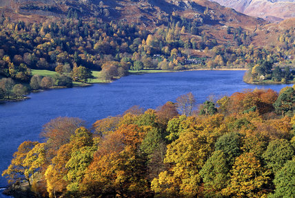 View across the slopes and lake in Grasmere Valley, Cumbria, with trees in their autumn colours