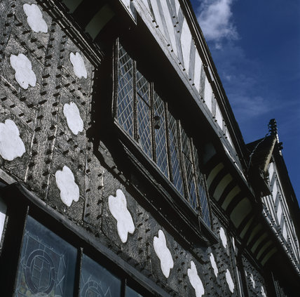 An oblique close-up of Speke Hall, focussing on the windows