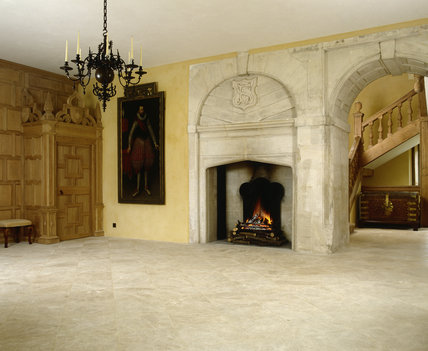 View of Entrance Hall showing stone fireplace & stone panelled arch