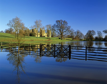 Bodiam Castle seen from the flooded Overflow Car Park