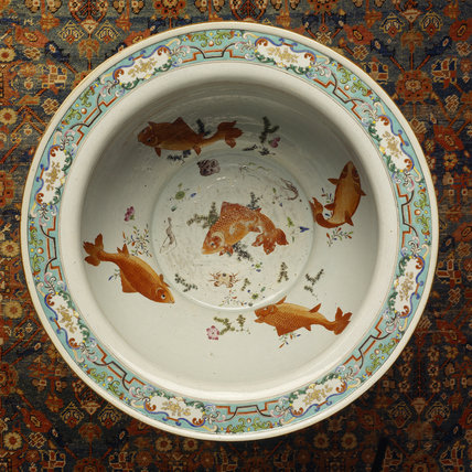 A ceramic dish with a number of orange fish (possibly carp) painted on the inside
