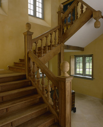 Partial view up 'brown' oak staircase from bottom, copied from a contemporary building, designed by Nicholas Stone & built by the Strong family of masons