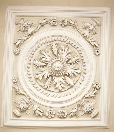 Close-up of a plasterwork roundel by Bradbury and Pettifer, on the ceiling of the Long Gallery