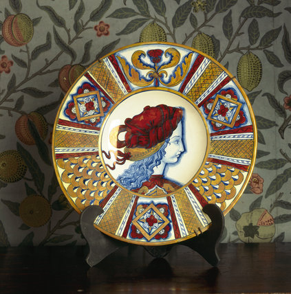 A Lustreware plate in the style of Italian Gubbio ware in the Pomegranate Passage at Wightwick Manor