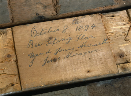Close up of signed floorboards (1894) uncovered during restoration at Llanerchaeron, a Nash house designed in the 1790's