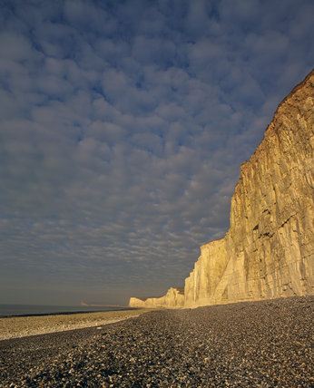 The Seven Sisters stretching along to the Birling Gap, with the cliffs catching a golden glow from a low January sun
