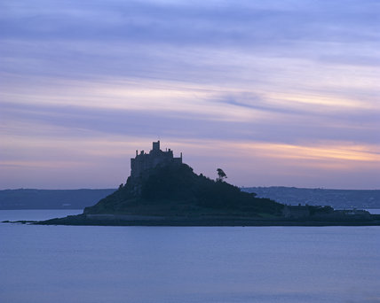 St. Michael's Mount taken at dusk with the Mount in silhouette against a pinkish, purple sky.