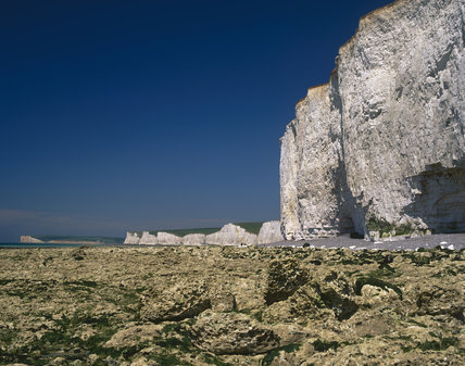 Looking along the length of the Seven Sisters Cliffs, with the rocky shore in the foreground