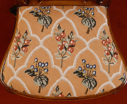 George I style walnut dining-chair tapestry seat in a repeat flower design embroidered by 3rd Lord Bearsted, in the Dining Room at Upton House