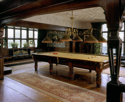 The Billiard Room at Wightwick Manor with the table set up for a game