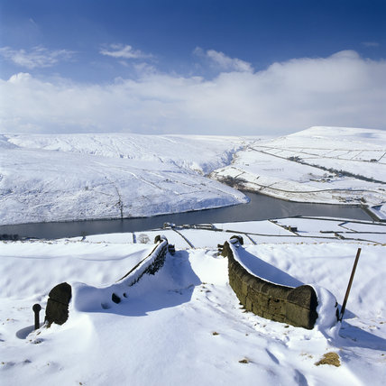 Looking west to Marsden Moor from Binn Moor, over the snow covered landscape with Butterley Reservoir in the centre and Pule Hill on the right