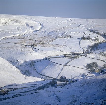 Looking north, over the snow covered landscape, from Pule Hill, with Cudwith Hill on the right and the hamlet of Lower Green Outers in the centre