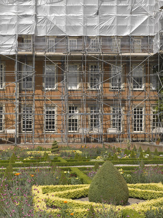 Outdoor conservation - view over the parterre garden to the scaffolding and protective cover whilst working on the roof at Hanbury Hall, Worcestershire