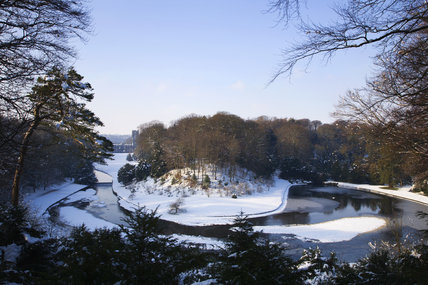 The Weir and River Skell at Fountains Abbey, North Yorkshire, in the snow