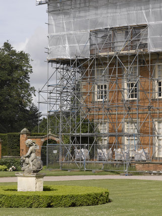 Outdoor conservation - scaffolding and protective cover whilst working on the roof at Hanbury Hall, Worcestershire