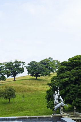 Statue of Diana on the roof at Lyme Park, Cheshire, overlooking the parkland which surrounds the house