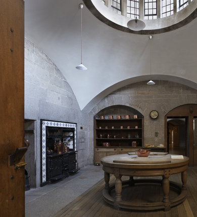 The Kitchen at Castle Drogo, Devon, with the circular beechwood table designed by the architect of the house, Edwin Lutyens