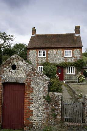 Seventeenth century flint cottage in the village on the Slindon Estate, West Sussex
