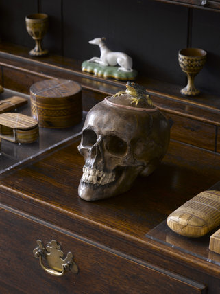 Japanese porcelain jar and cover modelled as a skull topped by a frog, on the dresser in the Entrance Hall at Greenway, Devon, which was the holiday home of the crime writer Agatha Christie between 1938 and 1976