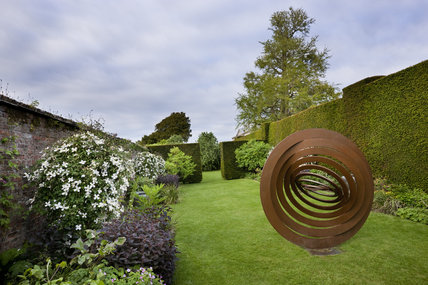 Hypercone by Simon Thomas of Bristol, sculpture in the Clematis Garden in May at Antony, Cornwall