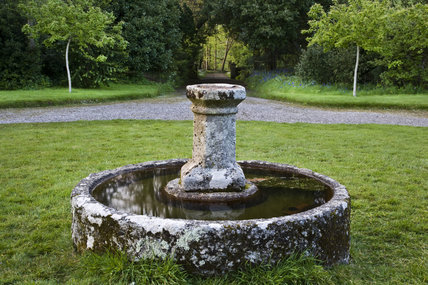 Circular water trough at the front of Godolphin House, near Helston, Cornwall