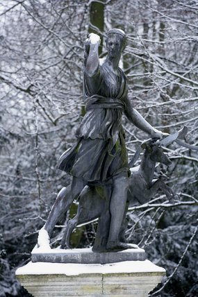 The statue of Diana at the end of the Croquet Lawn at Polesden Lacey, Surrey, in the snow
