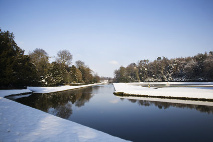Snow at Studley Royal Water Garden, North Yorkshire, with a view along the Canal