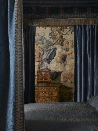 A view through the bed hangings in the Blue Room at Hardwick Hall, Derbyshire
