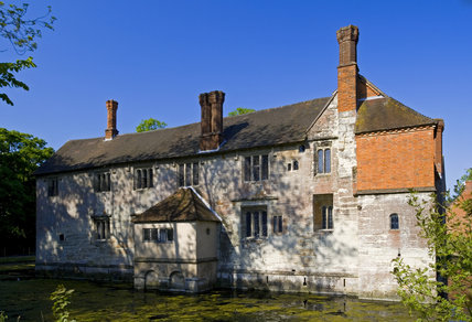The Family Range, or west side, seen across the moat at Baddesley Clinton, Warwickshire