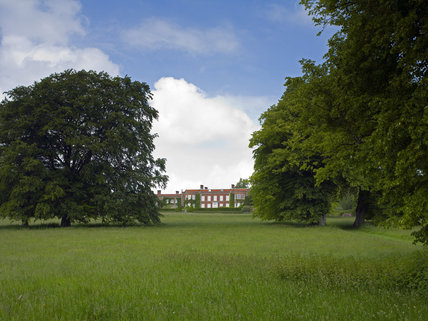 A long view over the park towards the south front of Hinton Ampner, Hampshire