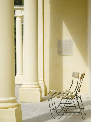 Garden chairs on the loggia at the side of the house at Greenway, Devon, which was the holiday home of the crime writer Agatha Christie between 1938 and 1976