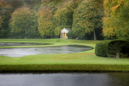 The Temple of Piety seen over the Canal and Half Moon Pond at Studley Royal Water Garden, adjoining the estate at Fountains Abbey, North Yorkshire