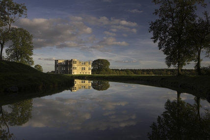 Glorious view from the west, across the moat, towards Lyveden New Bield near Oundle, Northamptonshire, with the West Wing central