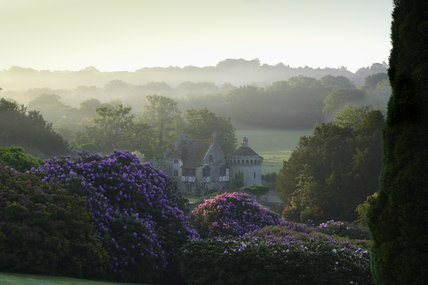A long view in the early morning to the ruins of the fourteenth-century moated Scotney Castle, Lamberhurst, Kent, set amidst beautiful gardens