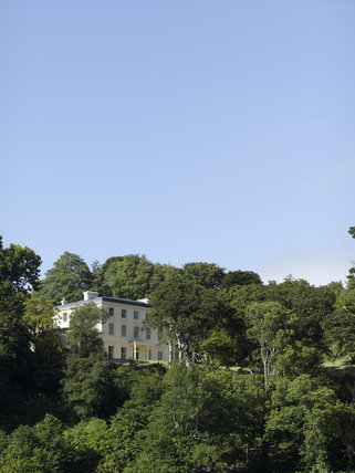 The view of the house at Greenway, Devon, from the approach along the Dart Estuary