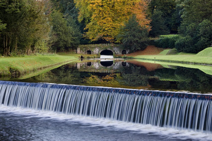 The Drum Fall and Rustic Bridge at Studley Royal Water Garden, adjoining the estate at Fountains Abbey, North Yorkshire