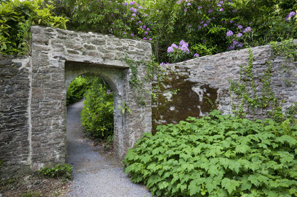 Stone archway in the garden at Greenway, Devon, which was the holiday home of the crime writer Agatha Christie between 1938 and 1976