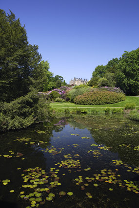 The beautiful gardens and moat which surround the C14th ruin and the C19th house at Scotney Castle, Lamberhurst, Kent