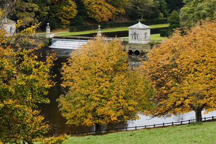 An autumn view to the lake from the deer park at Studley Royal Water Garden, North Yorkshire