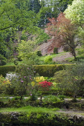 The garden was created along the valley of the River Bollin in the late eighteenth century by Samuel Greg, the mill owner, and his wife Hannah, to complement their house, part of the Quarry Bank Mill and Styal Estate, Wilmslow, Cheshire