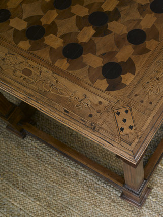 Close view of a marquetry topped games table, English c.1580, in the Withdrawing Chamber at Hardwick Hall, Derbyshire.