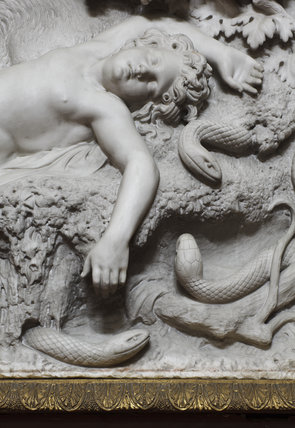 Close view of a sleeping boy and serpents in a relief of The Dream of Horace by Sir Richard Westmacott RA (1775-1856) in the Central Corridor of the North Gallery at Petworth House, West Sussex