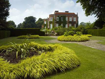 The Yew Garden in June and East front of the house at Hinton Ampner, Hampshire