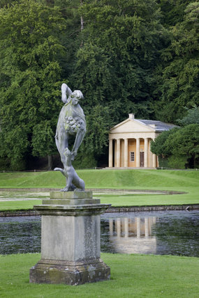 The lead statue of Bacchus in front of the Temple of Piety at Studley Royal Water Garden, North Yorkshire