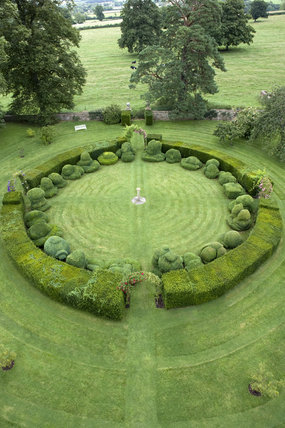 An overhead view of the circular topiary arrangement from the roof of Chastleton House, Oxfordshire