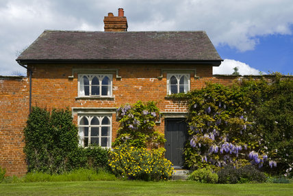 Wisteria and cottage in the Walled Garden at Croft Castle, Herefordshire