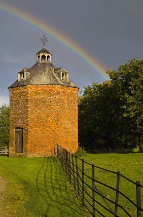 A rainbow above the eighteenth-century dovecote at Erddig, Wrexham, Wales