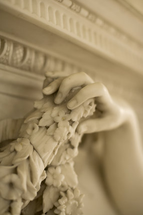 Detail of the Adams fireplace in the Long Gallery at Croome Court, Croome Park, Worcestershire, with life-size marble Nymphs of Flora