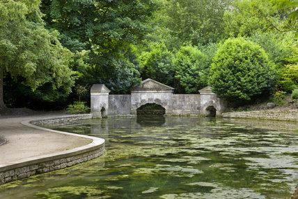 The Sham Bridge with vermiculated stone and three pediments, in the Wilderness at Prior Park Landscape Garden, Bath